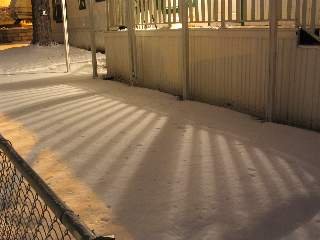 Shadows on snow at night